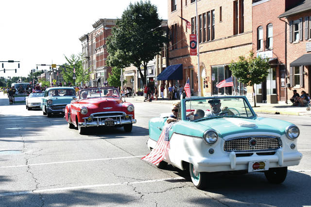 Cody Willoughby | Troy Daily News A coterie of colorful cars make their way down Main Street during the City of Troy Independence Day Parade on Wednesday.