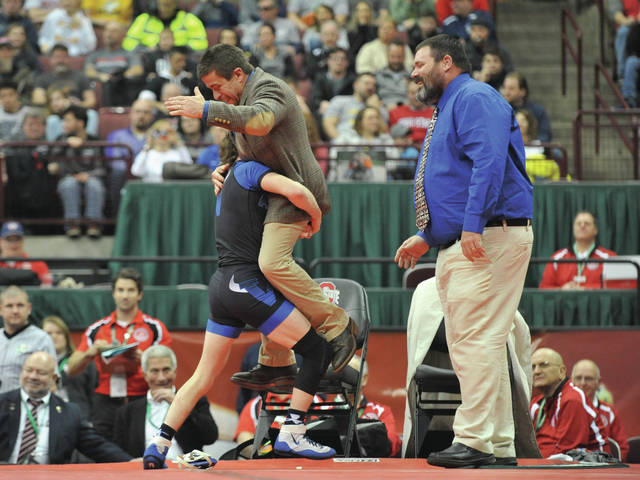 Josh Brown | Troy Daily News file photo Miami East's Graham Shore (left) celebrates his state title with assistant coach Rich Randall and head coach Mark Rose (right).