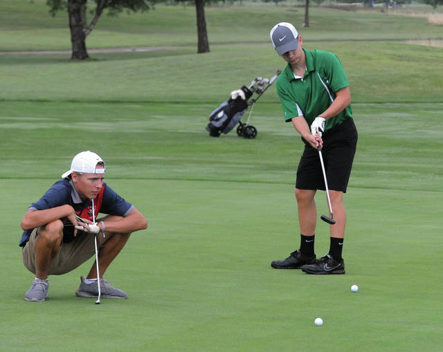 Mike Ulllery/AIM Media Bethel's Ryan Santo putts while Piqua's Jackson Huelskamp lines up his own shot during the Kendig Memorial Wednesday at Echo Hills.