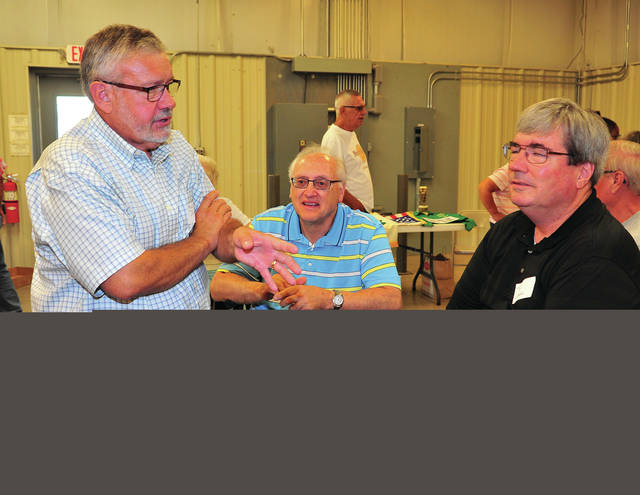 Mike Ullery | AIM Media Midwest Miami County 4-H club alumni Mark Davis, Rodney Bair, and Tom Goedde, left to right, chat in the Duke Lundgard Building on Saturday during the second annual Miami County 4-H reunion.
