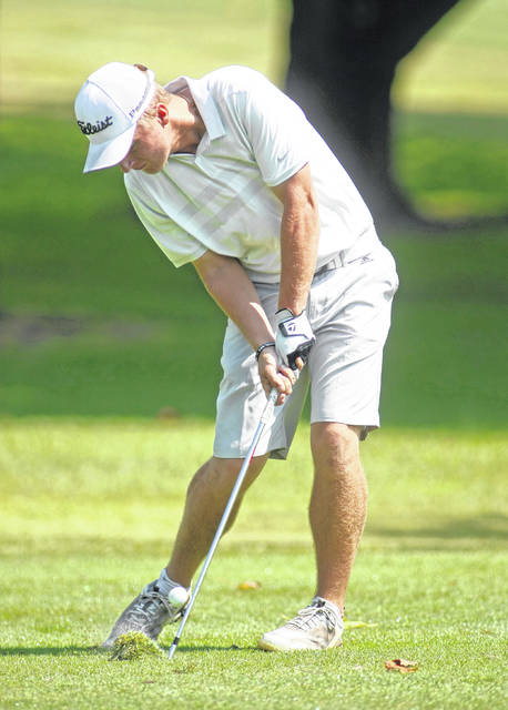 Photo courtesy Lee Woolery/Speedshot Photo Troy's Holden Scribner hits an approach shot from the fairway during the Troy Invitational Monday at Troy Country Club.
