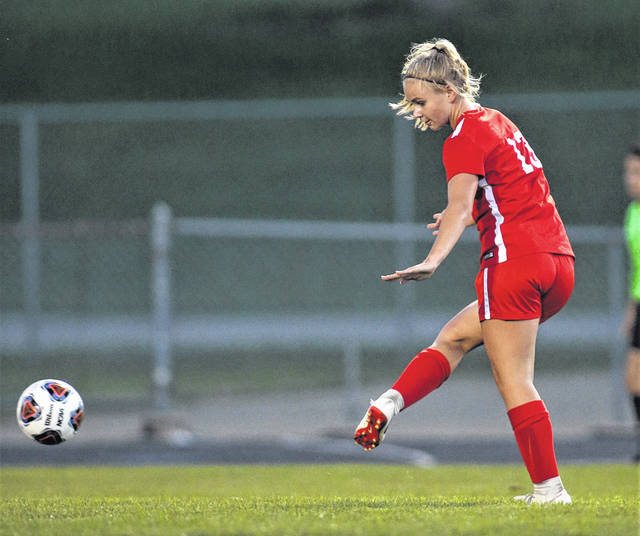 Photo courtesy Lee Woolery/Speedshot Photo Troy's Maddie Brewer scores a long goal against Wayne Wednesday at Troy Memorial Stadium.