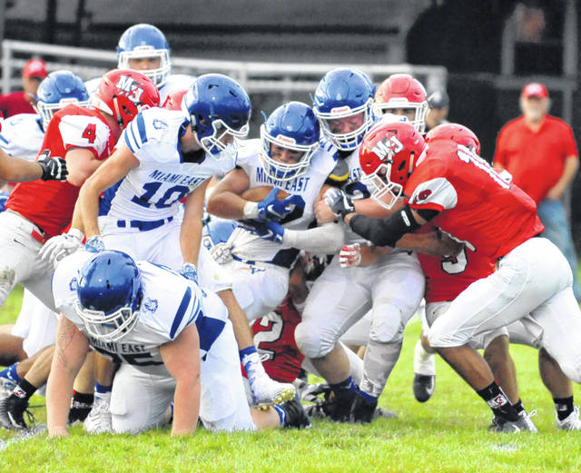 Josh Brown | Troy Daily News Miami East's Vincent Villella pushes the pile in the middle of the line during Friday's season opener at Milton-Union.