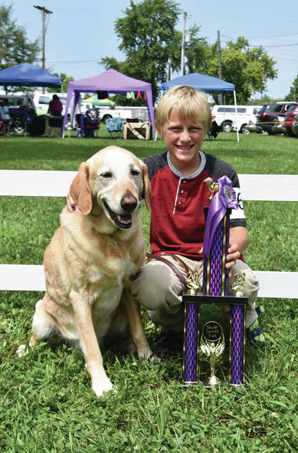 Cody Willoughby | Troy Daily News Mattias Hilliard, of Troy, won the 2018 Miami County Fair first place Showmanship Junior Division A trophy with his dog, Mellie. He is a member of the Perfect Paws 4-H Club and is the son of Brian Hilliard and Angela Wegscheider.
