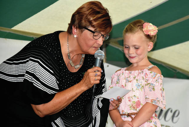 Cody Willoughby | Troy Daily News Event emcee Dee Mahan conducts an interview with princess candidate Natalie Parke on Friday during the 2018 Miami County Fair. Miss Parke went on to be awarded 2018 Miami County Fair Princess.