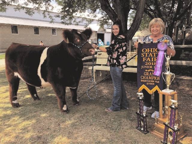 Kassidy Thompson, 18, of Troy, enjoyed a banner year with her champion steer, Worm. Thompson won a variety of shows at the Miami County Fair and found success at Ohio State Fair. She will participate in Wednesday's Sale of Champions. Pictured at right is her grandmother, Jane Thompson, of West Milton.