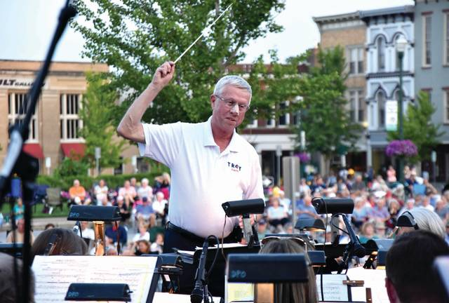 "Cody Willoughby | Troy Daily News Mayor Mike Beamish serves as conductor to a rendition of ""His Honor March"" during the 26th annual Troy Mayor's Concert with the Dayton Philharmonic Orchestra on Sunday in Prouty Plaza. The concert, themed ""Lights of Broadway,"" featured vocalists Alaina Saliba and guest conductor Danny Elam, and was free to the public."