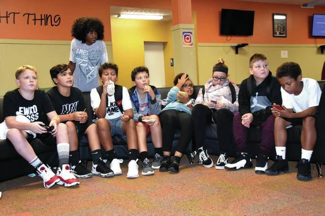 Cody Willoughby | Troy Daily News From left, Jayden Horn, Zack Campbell, Elijah Cook, Christopher King, Xavier Adkins, Kailynn Warren, Kaira Bilbrey, Brayden Bruce, and Landon Banks spectate a gaming session on Thursday at the Rec's after school program, now open Monday through Friday on North Market Street in Troy. Available for free to students grades 6-12, The Rec seeks to provide a supervised fun location for local teens to play games, do homework, and hang out. For more information, visit www.troyrec.com.
