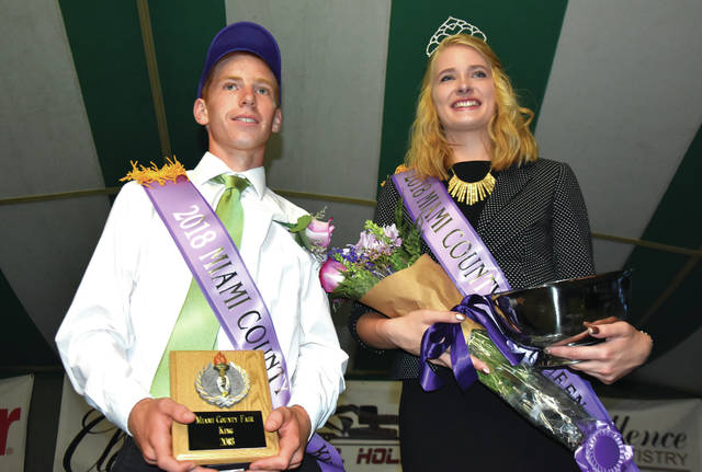 Cody Willoughby | Troy Daily News Miami County residents Michael Bair and Kelci Cooper stand together after being crowned 2018 Miami County Fair King and Queen on Friday at the fairgrounds. The fair, which opened on Friday, is set to continue through Thursday, Aug. 16.
