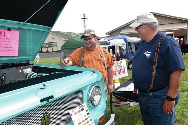 Cody Willoughby | Troy Daily News Jon Spires Eauclair, Wis. and Larry Spires of Lakeville, Ill. discuss a 1962 IH Scout 80 during the 29th annual International Harvester Scout & ALL Trucks Nationals 2018 event on Friday at WACO Air Museum & Learning Center. This marks the center's sixth year hosting the event, which continues through Sunday.