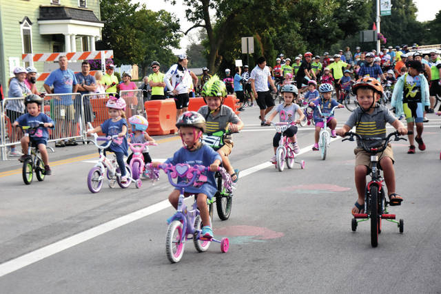 "Cody Willoughby | Troy Daily News Young cyclists participate in the children's race ahead of the ""Tour de Donut"" on Saturday in Troy."