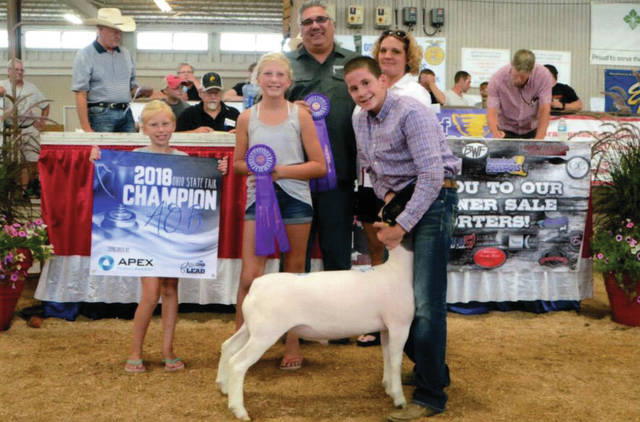 Provided photo Jacob Roeth of Troy, center with his prize-winning lamb. Also pictured are his family and buyers' representatives.