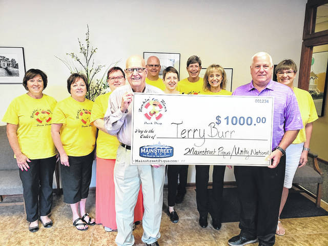 Provided photo Terry Burr of Troy, grand prize winner of the 4th Annual Rockin' River Duck Drop was awarded at check for $1,000 on Tuesday. The Duck Drop was held in Piqua's Lock 9 Park on Aug. 18.