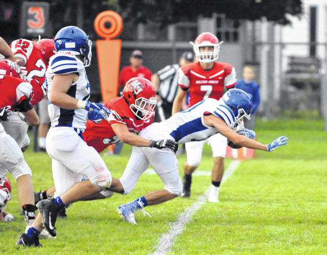 Josh Brown|Troy Daily News Miami East's Justin Brown breaks the plane on a touchdown run against Milton-Union in the Vikings' season opener.