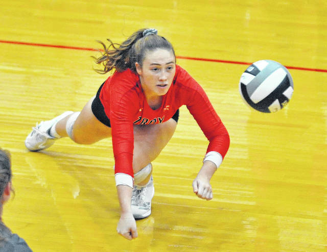 Josh Brown|Troy Daily News Troy's Alexa Holland makes a diving one-handed save during the second set of a match at Piqua Tuesday night.