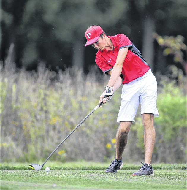 Lee Woolery|Troy Daily News Troy's Travis Bertram tees off against Sidney Wednesday at Miami Shores Golf Course.