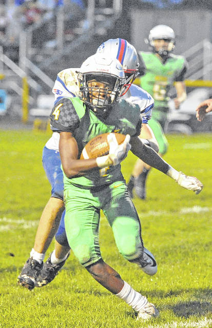 Josh Brown|Troy Daily News Bethel's Kendal James makes a cut on the way to the end zone Friday against Tri-Village.