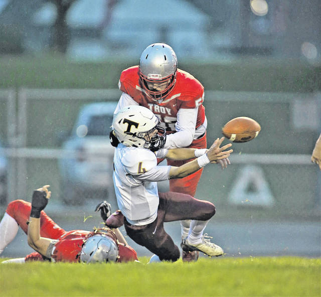 Lee Woolery|Troy Daily News Troy's Adam Decerbo forces a safety during Friday's game against Turpin at Troy Memorial Stadium.