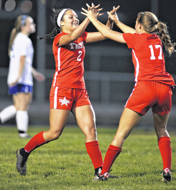 Lee Woolery|Troy Daily News Troy's Kiyha Adkins (2) celebrates with Julianna Williams (17) after Adkins scored her second goal of the night in a 3-0 Trojan win over Xenia Wednesday at Troy Memorial Stadium.