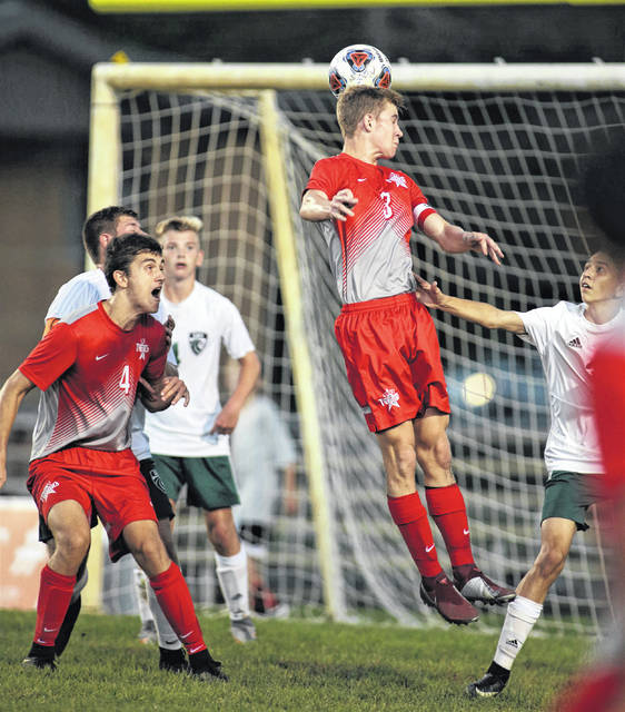 Lee Woolery|Troy Daily News Troy's Connor Hubbell hits a header in front of the Greenville goal Thursday at Troy Memorial Stadium.
