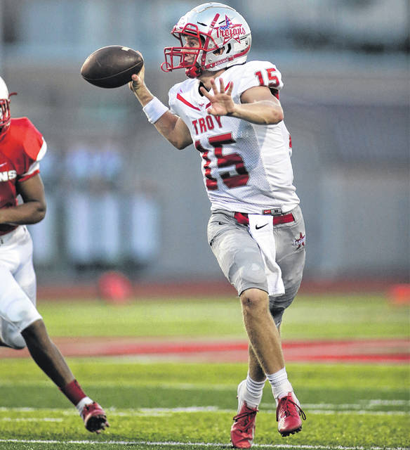 Lee Woolery | Troy Daily News Troy quarterback Brayden Siler looks for an open receiver last week against Stebbins.