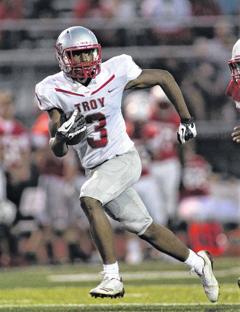 Lee Woolery | Troy Daily News Troy receiver Caillou Monroe burns the Stebbins defense for a long gain Friday.