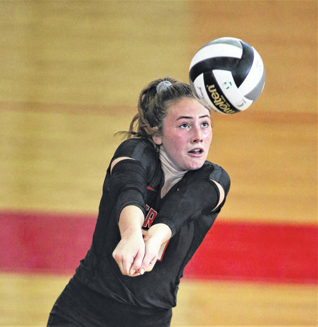 Lee Woolery|Troy Daily News Troy's Alexa Holland passes the ball Saturday against Versailles.