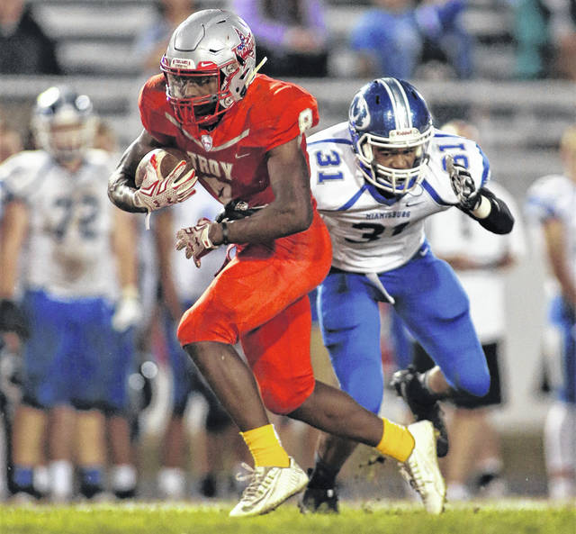 Lee Woolery | Troy Daily News Troy's Jaydon Culp-Bishop fights for extra yards Friday against Miamisburg at Troy Memorial Stadium.