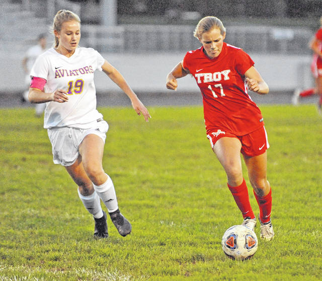 Josh Brown|Troy Daily News Troy's Julianna Williams gets around Butler's Skylar Rose on her way to scoring a goal Wednesday at Troy Memorial Stadium.