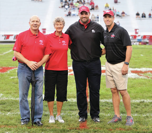 Lee Woolery | Troy Daily News This year's Troy Athletic Hall of Fame inductees (from left-right), Dan Cox, Vickie Felver, Todd Denlinger and Jason Manson, are introdcuted prior to Troy's football game against Turpin Friday at Troy Memorial Stadium. Also inducted into the hall of fame over the weekend was Hildred Byrkett, who passed away in 2006.