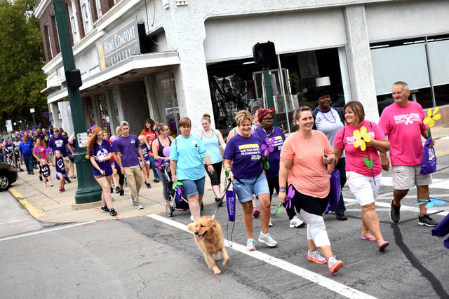Cody Willoughby | Troy Daily News Hundreds of participants pace east on Main Street during the 15th annual Miami County Walk to End Alzheimer's on Saturday in downtown Troy.