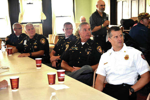 "Cody Willoughby | Troy Daily News From left, police officers Dave Norman, Frank Lockhart, and Tom Wheeler, along with Sheriff David Duchak and Fire Chief Matt Simmons attend the ""First Responder's Breakfast"" on Wednesday at the Miami Valley Veterans Museum in Troy."