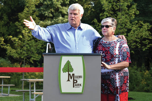 Cody Willoughby | Troy Daily News Dr. Paul and Tanya Kroger address attendants at a special dedication of the new Dr. Paul and Tanya Kroger Legacy Grove at Charleston Falls Preserve on Thursday.