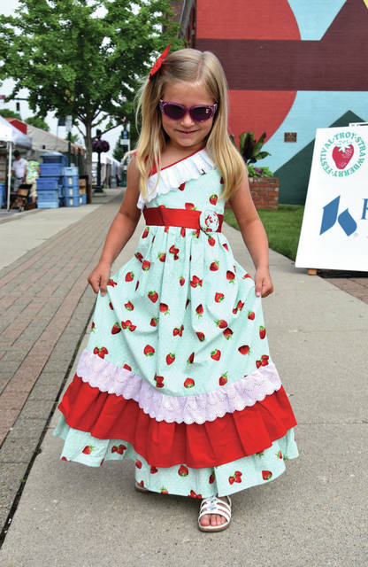 Little Miss contestant Kinlee Otis does her best curtsy ahead of the 42nd annual Troy Strawberry Festival welcome ceremony at Prouty Plaza on Saturday, June 2 in Troy.