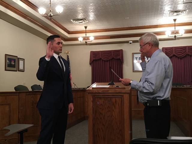 Officer Brian O'Neal is sworn in by Mayor Michael Beamish on Monday.
