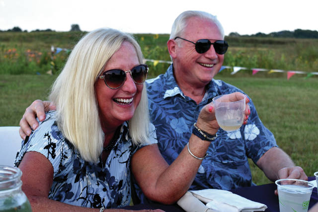 Cody Willoughby | Troy Daily News Kristine and Lee Goodson, of Piqua, enjoy the locally produced food and beverages served at the fifth annual Food to Table Locavore Dinner on Thursday at Fulton Farms.