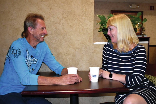 Cody Willoughby | Troy Daily News Dennis Kerg, of Tipp City, and Tiffany Ostazewski, of Epping, N.H., chat over coffee at Holiday Inn Express on Thursday in Troy. The biological father and daughter were united for the first time on Wednesday after nearly 40 years.