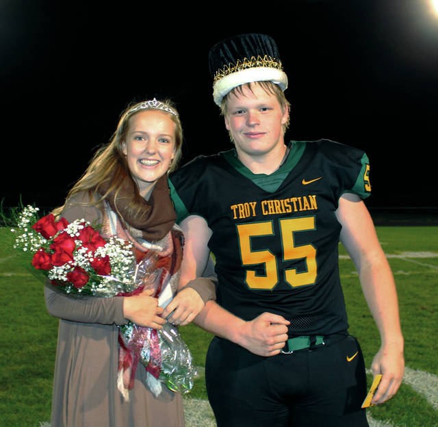 """Provided photo Troy Christian named their Homecoming king and queen during the football game Friday night against Ponitz Career Technology Center. Nick Baker was named king while Abby Baker was crowned queen. The Homecoming dance, themed """"Light Up The Night!"""" was held Saturday night at the Signature Lounge in Troy."""