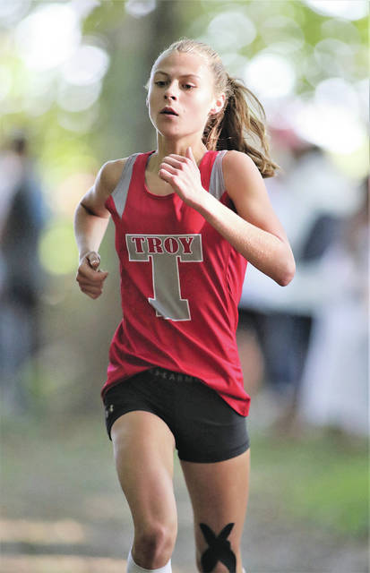 Lee Woolery   Miami Valley Sunday News Troy freshman Emma Kennett won the Miami County Cross Country Championship race Saturday at Lowry Park in West Milton.