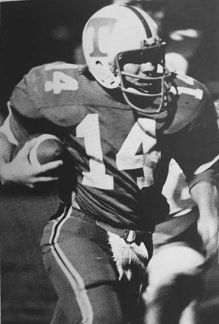 Photo Courtesy of Troy High School Former Troy and University of Toledo multi-sport athlete Dan Cox, shown here playing quarterback for the Trojans, will be inducted into the Troy Athletic Hall of Fame this weekend.