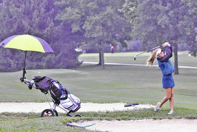 Rob Kiser|AIM Media Miami East's Paige Lawson watches her approach shot on the 10th hole at the Division II sectional tournament Wednesday at Stillwater Valley Golf Club.