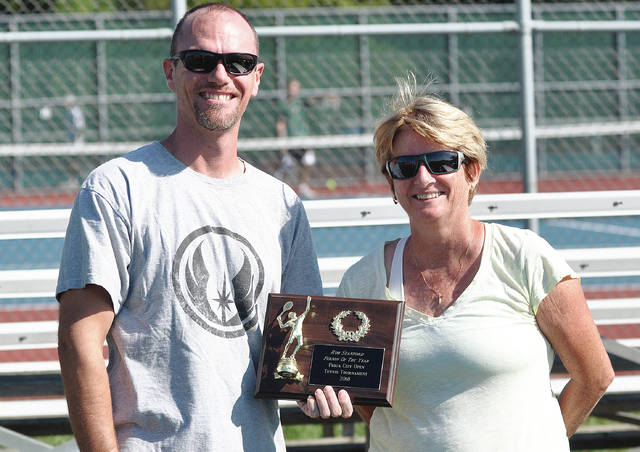 Rob Kiser/Call Photo Rob Sanford is presented the plaque for Piqua Open Person of the Year by tournament manager Bonnie Davis.