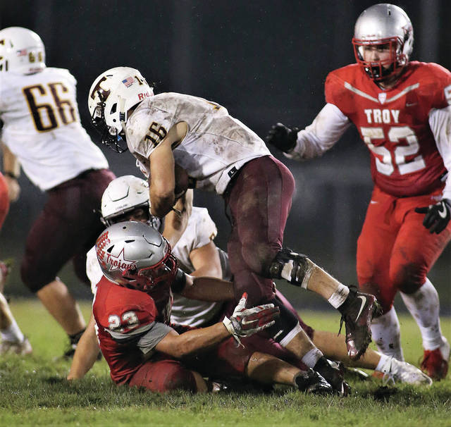 Lee Woolery | Troy Daily News Troy linebacker Shane Shoop (23) makes a stop against Turpin Friday at Troy Memorial Stadium.