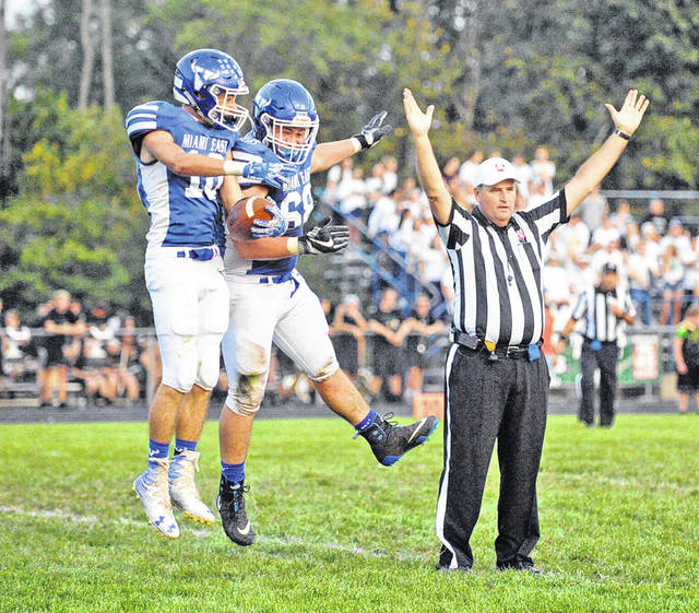 Josh Brown|Troy Daily News file Miami East's Justin Brown (10) and Brenden Dalton (68) celebrate Brown's fumble return for a touchdown earlier this season against Bethel.