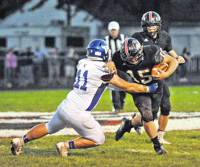 Josh Brown|Troy Daily News file Covington's Gage Kerrigan slips out of a tackle earlier this season.
