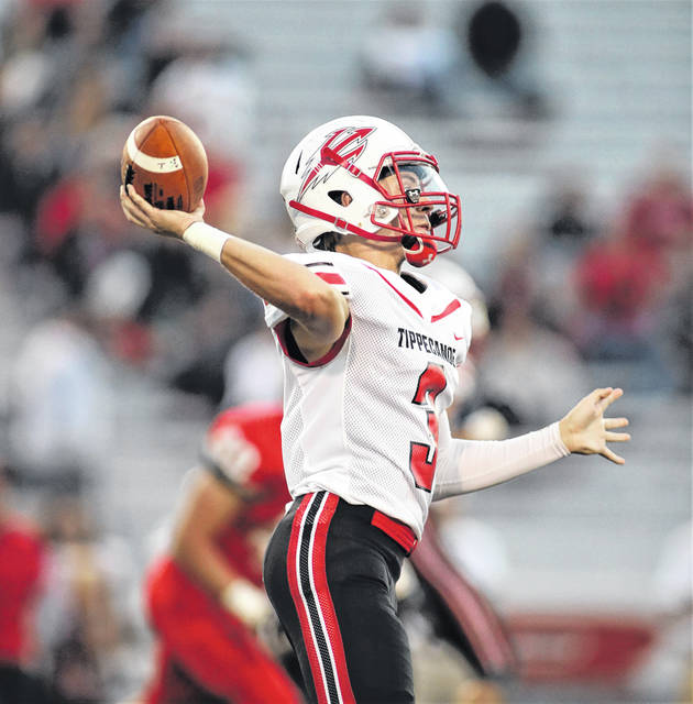 Lee Woolery | Troy Daily News Tippecanoe quarterback Troy Taylor delivers a pass againt Troy last week.