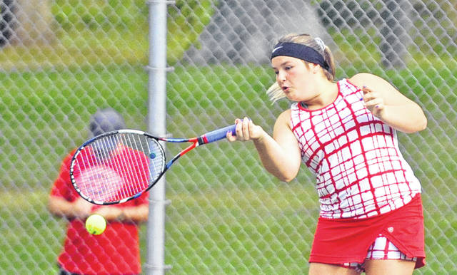 Josh Brown|Troy Daily News Milton-Union's Taylor Falb hits a forehand at the Division II sectional tournament Tuesday at Troy Community Park.