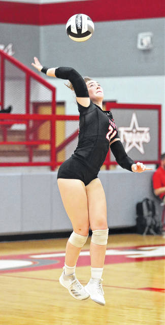 Lee Woolery|Troy Daily News Troy senior Alexa Holland serves Tuesday against Sidney.