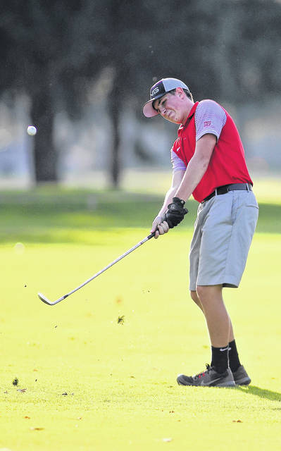Lee Woolery|Troy Daily News Troy senior Nathan Henderson chips onto the green against Tippecanoe Wednesday at Troy Country Club.