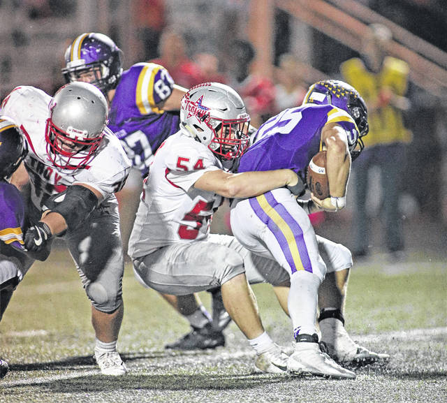 Lee Woolery | Troy Daily News Troy defensive lineman Austan Good (54) drags down a Butler ballcarrier last Friday.